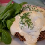 Latkes Benedict with duck pastrami, poached egg and russian hollandaise