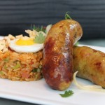 Thai Sausage made with pork, lemongrass, red curry, green papaya served with a side of basil fried, egg-topped rice
