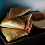 Samosas with sweet peas, Kaffir lime yogurt, and a golden raising chutney